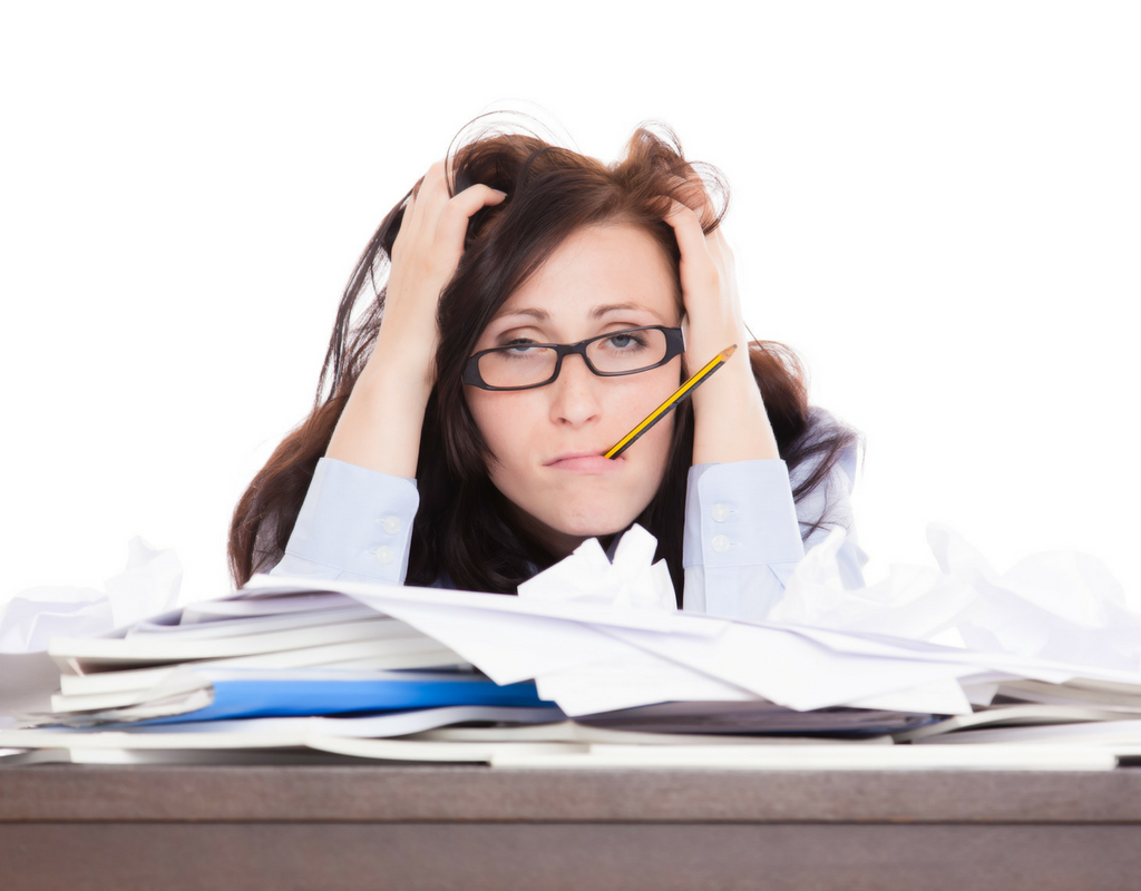 woman with hands on paper clutter